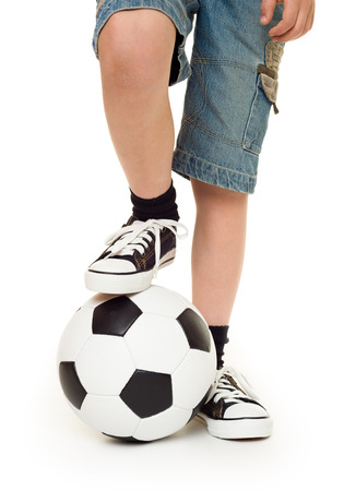 feet shod in sneakers and soccer ball studio isolated photo