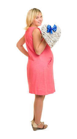 pregnant woman with heart and blue bow isolated photo