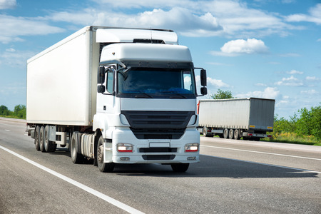 truck on highway: White truck on road. Cargo transportation Stock Photo