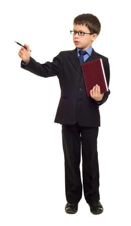school boy in suit with pen and book point at photo