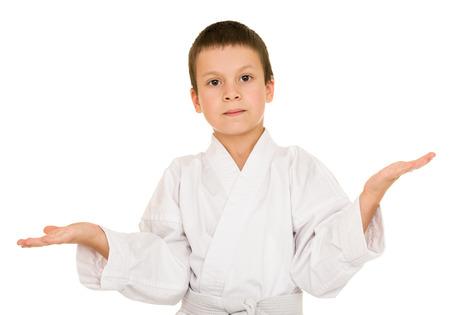 arts: boy in white kimono posing Stock Photo