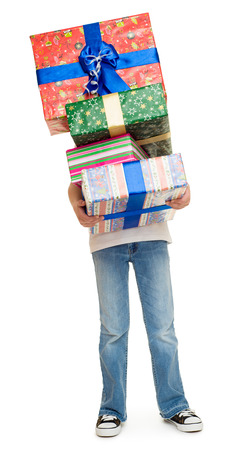 boy with stack of gift boxes photo