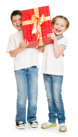 two child with gift boxes on white photo