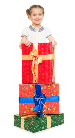 girl with gift boxes on white photo