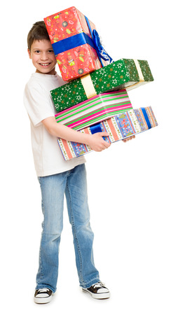 boy with gift boxes on white photo