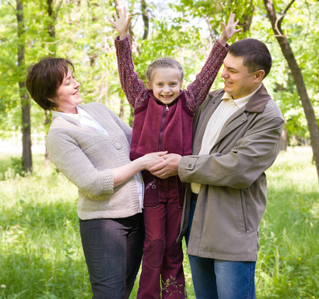 Family in the park at spring photo