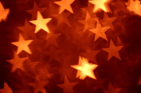 dark red: red star shape holiday photo as background Stock Photo
