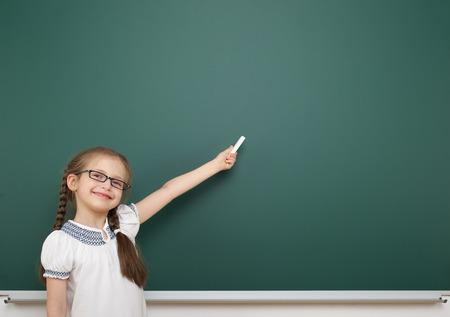 school board: Schoolgirl near the school board