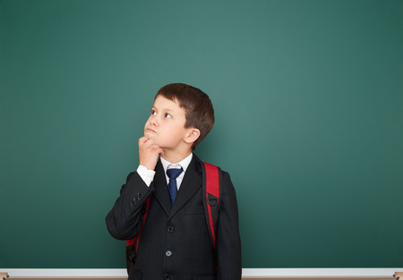 schoolboy: Schoolboy near the school board