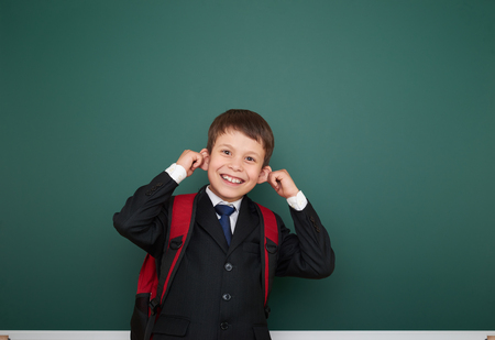 schoolboy: Schoolboy with backpack on school board background