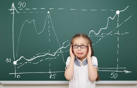 child studying: girl horrified by the graphic drawing on school board