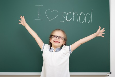 i love: girl drawing i love school on board