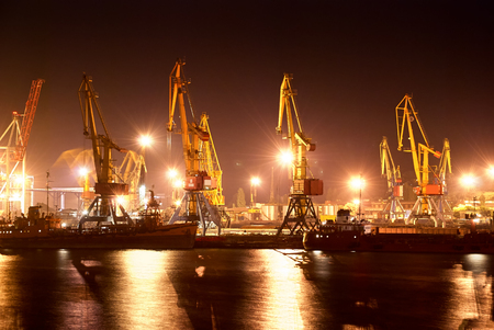 docks: night view of the industrial port with cranes Stock Photo