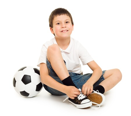 ball isolated: football boy with soccer ball studio isolated white background