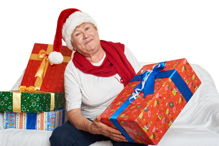 grand kids: elderly woman with christmas box gift - happy holiday concept Stock Photo