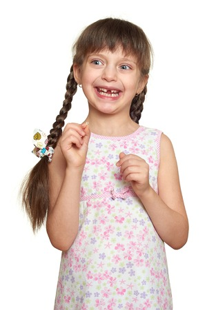 one child: lost tooth girl portrait, studio shoot on white background