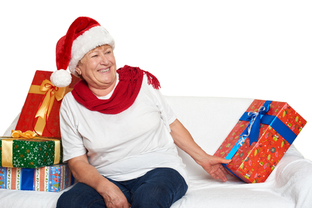 grand kid: elderly woman with christmas box gift - happy holiday concept Stock Photo