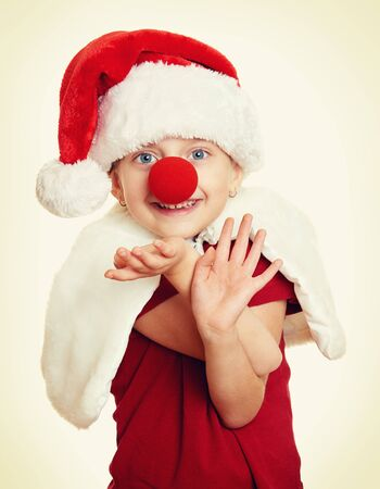 clown nose: girl in santa hat with clown nose on white isolated