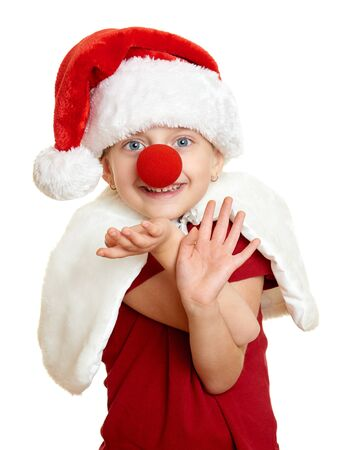 santa hat: girl in santa hat with clown nose on white isolated