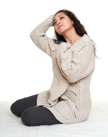 homelike: woman portrait in homelike dress sit on fur floor, white background
