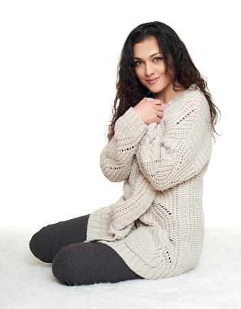 homelike: girl portrait in homelike dress sit on fur floor, white background Stock Photo