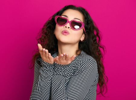 kisses: beautiful girl glamour portrait on pink make flying kiss