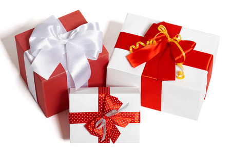 three objects: gifts boxes with ribbon and bow on white background, a group of three objects Stock Photo