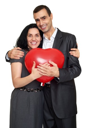 guy portrait: Happy couple portrait with red heart shaped balloon. Valentine holiday concept. Studio isolated Stock Photo