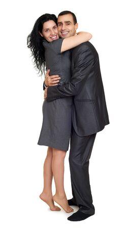 studio portrait: Happy couple embrace, dressed in strong classic dress, studio portrait on white Stock Photo
