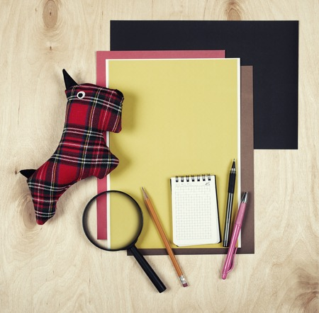 brown background: Flat lay office tools and supplies. Education background with stationery on wood. Stock Photo