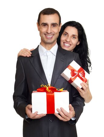 love hug: Couple with gift box, studio portrait on white. Dressed in black suit.