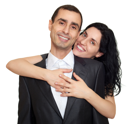 relationship love: Couple embrace, studio portrait on white. Dressed in black suit.