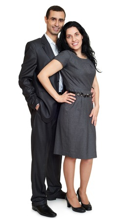 couple background: Couple embrace, studio portrait on white. Dressed in black suit.
