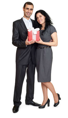 studio portrait: Couple with gift box, studio portrait on white. Dressed in black suit.