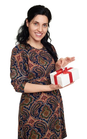 spaniard: Woman portrait in eastern ethnic ornament dress and gift box on white at studio