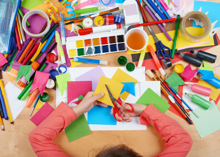 creative tools: Child cut applique top view. Artwork workplace with creative accessories. Flat lay art tools for painting. Stock Photo
