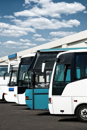 motorbus: buses at the bus station with cloudy sky