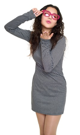 flying kiss: young woman make flying kiss beautiful portrait, black and white checkered dress, pink sunglasses in heart shape, long curly hair, glamour concept, isolated on white background