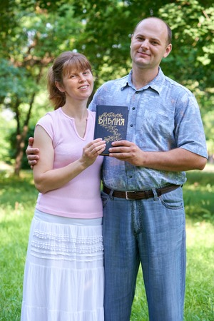 man and woman with a Bible in his hand Stock Photo