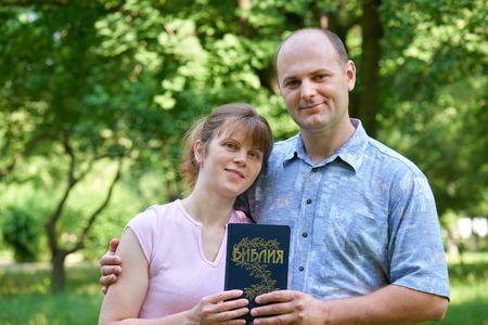 missionary: man and woman with a Bible in his hand Stock Photo