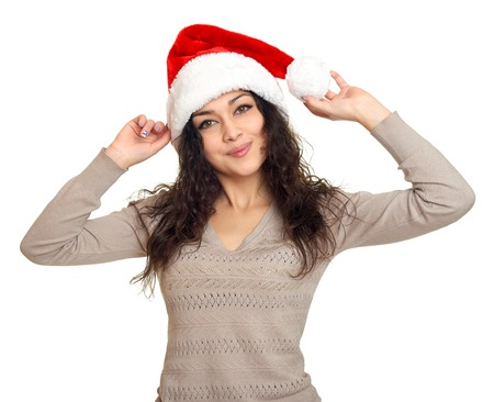 black sweater: girl in santa hat portrait on white background, christmas holiday concept Stock Photo