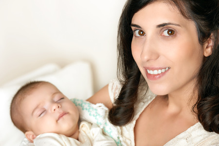 mother with sleeping baby portrait, happy maternity concept Stock Photo