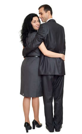 couple rear view, people backside look around, dressed in classic suit, full length on white background