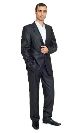 businesslike: adult man in black suit posing, white space background