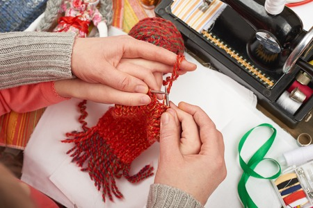 mother teaching daughter girl knit, top view, sewing accessories top view, seamstress workplace, many object for needlework, handmade and handicraft Stock Photo