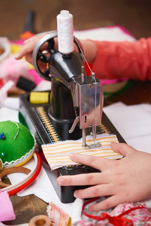 mother teaching daughter girl sew, job training, handmade and handicraft concept