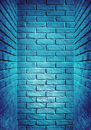 blue toned brick wall end of the corridor, abstract background photo Stock Photo