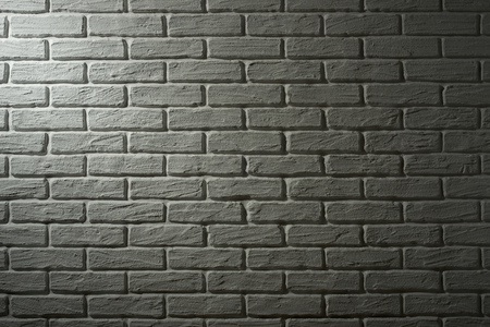 diagonal: white brick wall with light effect and shadow, abstract background photo