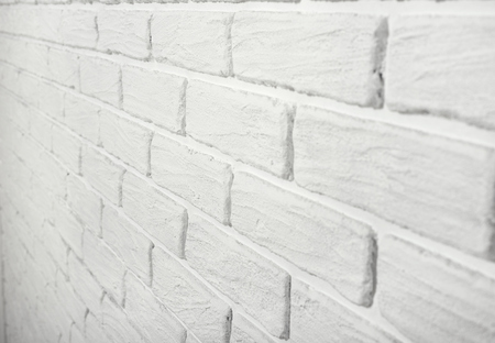tilting: white brick wall, angle view, abstract background photo