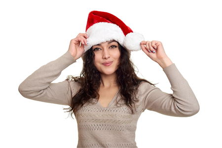 Beautiful girl portrait dressed in santa hat. White isolated background. New year eve and winter holiday concept.